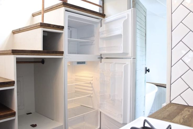 Storage-integrated stairs include the Urban Craftsman's refrigerator