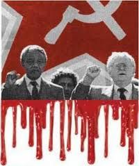 """Dead -- Nelson Mandela Was a Terrorist ~ Dec 5, 2013 ~ Nelson Mandela and Joe Slovo in Moscow give the clenched fist salute in front of the blood-drenched Hammer and Sickle flag of Illuminati Jewish Bolshevism. ~ Prepare for a nauseating outpouring of media praise for Illuminati puppet Nelson Mandela. Terrorists are """"freedom fighters"""" if they advance Illuminati agenda. (The real freedom fighters, like the Editor of the Guardian, ..)  - See more at…"""