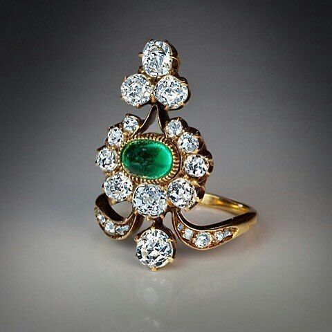 #Diamond ring centered with a cabochon cut #emerald. Via @romanov_russia #antiquejewelry #antiquejewellery http://ift.tt/2eT9aMh
