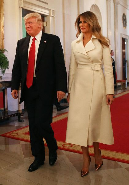 Melania Trump Photos Photos - Donald Trump and Melania Trump attend an event celebrating Women's History Month, at the White House March 29, 2017 in Washington, DC. - Donald Trump Attends a Women's Empowerment Panel at the White House
