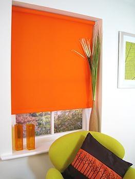 White cabinets, neutral warm-grey walls, orange blinds?