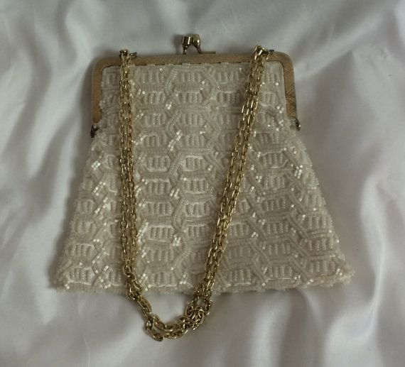Vintage beaded purse, ivory, with gold chain and clasp. Trapezoidal in shape. Interior has ivory satin.