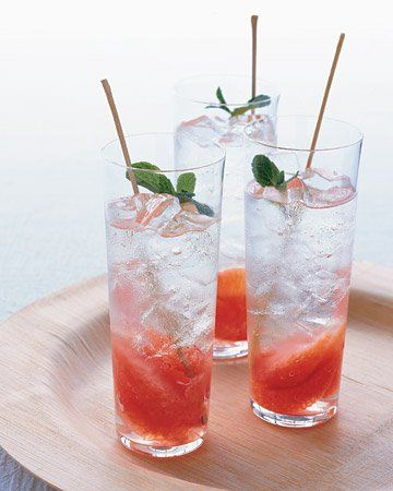 Grapefruit-and-Mint Mojito -- A simple mint syrup takes the place of crushed leaves in this grapefruit-mint mojito. Be sure to add fresh sprigs on top for a dash of color and heady aroma. Tall, slender glasses and long stirring sticks impart a modern elegance.