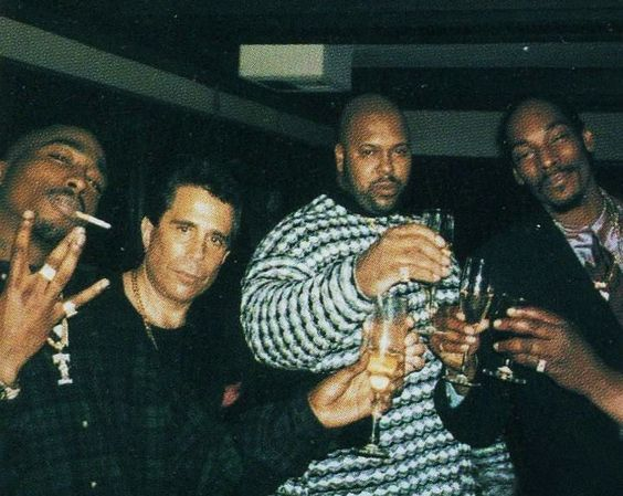 Tupac Shakur, Suge Knight, and Snoop Dogg