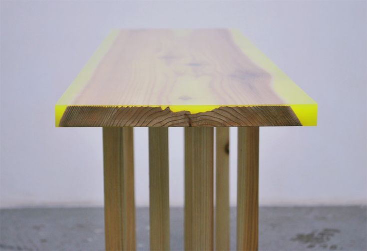 'flat table peeled' by Jo Nagasaka, Schemata Architecture Office (Japan) - a contemporary interpretation of the traditional japanese  hassoku dai, a low table with 8 legs, by using a plank as a table top that is then finished with a layer of colored epoxy resin in fluorescent pink or yellow   #table
