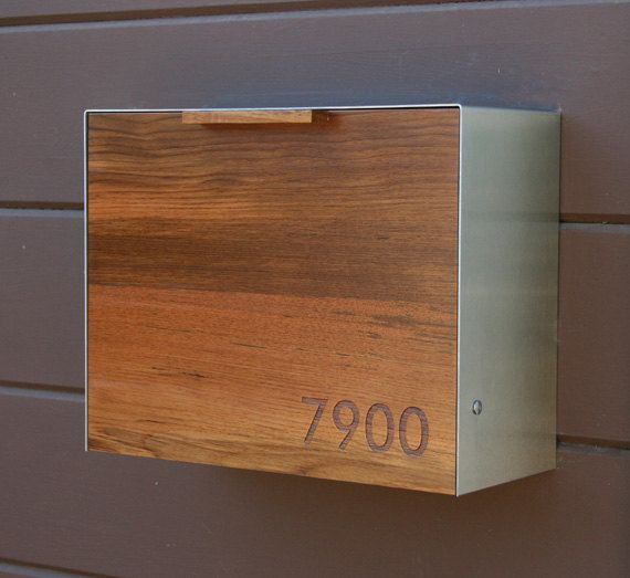 This stainless steel and Teak mailbox measures 14 5/8W x 11H x 6D. The wood gives the piece warmth and beauty while the thick 14ga Stainless Steel box