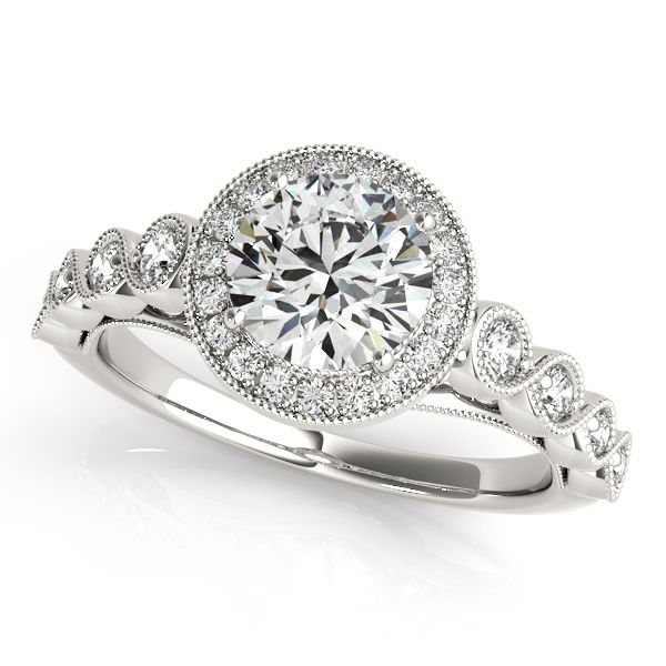 ''Regina'' Magnificent Vintage Filigree Diamond Halo Engagement Ring Alluring diamond side stone halo vintage filigree diamond engagement ring Mounting type: Unique Vintage Halo Band Width: 1.7 mm Extra Small Diamonds: 25-27 (1,4mm Each) Matching Wedding Band: 7 Small Round Cut Diamonds
