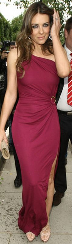 Elizabeth Hurley: Dress – Roberto Cavalli  Purse – Jimmy Choo