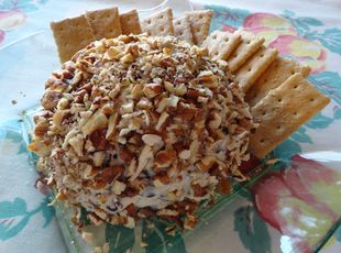 Chocolate Chip Cheese Ball! Oh wow, this is such a good, sweet appetizer! I just can't think of any better way to put it. You may be tempted to just use your finger for tasting, but we recommend serving with graham crackers.
