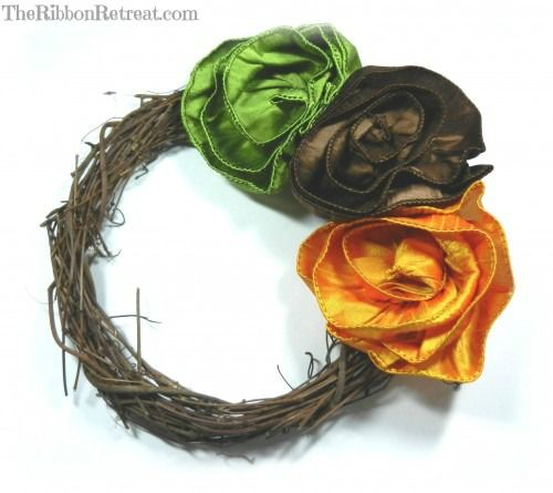 Wired Ribbon Rose - {The Ribbon Retreat Blog} - I'm making a wreath with Christmas patterned wired ribbon...