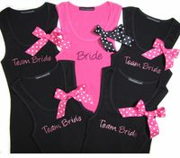 Bridesmaid T-Shirts for the rehearsal Diner and we could get the grooms men t-shirts that say Team Groom! Get a separate one for the best man and maid of honer and in different colors! Not pink!
