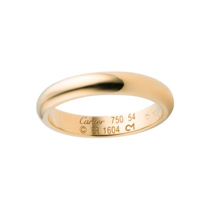 WEDDING BAND Yellow gold REF: B4031200 A symbol of shared happiness, Cartier wedding bands are created in the expert tradition of the Maison Cartier's master jewelers. 18K yellow gold wedding band. Width: 3.5 mm
