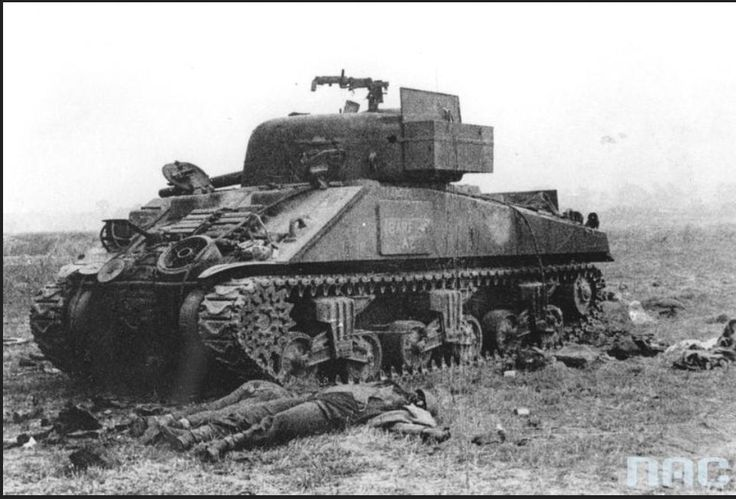 A Polish Sherman knocked out on 9 August 1944 by the 12th-SS Hitlerjugend. The crew laying side by side were executed in cold blood. The stowage bin on the turret is open and its contents strewn about by the young looters. Whatever tenacity the HJ showed in battle was marred by their callous murderous nature that resulted in 189 prisoners of war being executed after capture and countless examples such as this of wanton murder.