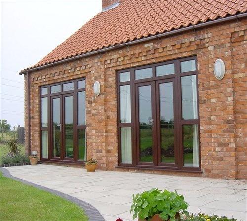 http://www.entrydoorwithsidelights.com/best-upvc-doors/ REHAU uPVC French Doors - Woodgrain finish