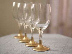 $4 for 4-pack Wal-Mart wine glasses? Check! Gold spray paint and tape? Check! Beautiful wine glasses that look like a million bucks? Priceless!