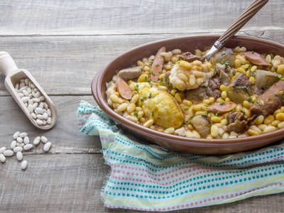 Slow-cooked smoked sausage with fresh spices, cannellini beans and ...