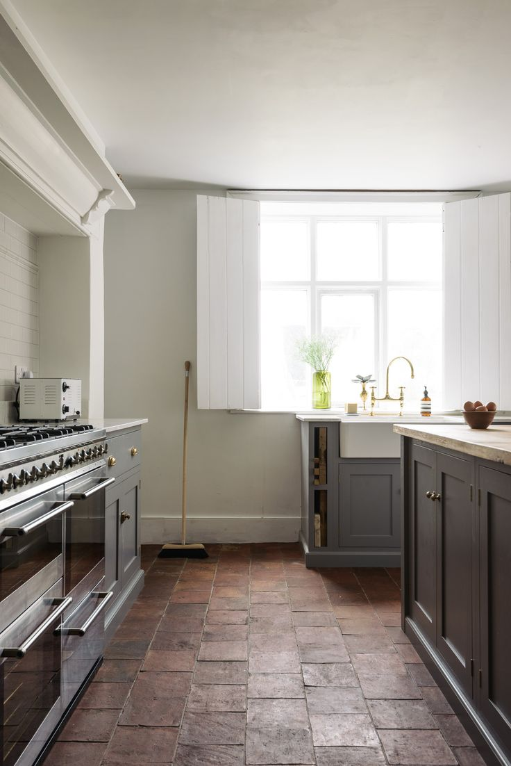 Simple living and pared back style in this grey shaker kitchen by deVOL