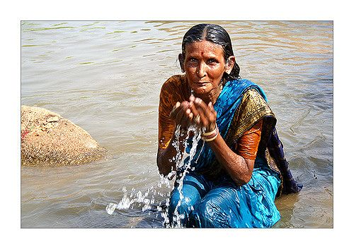 https://flic.kr/p/H5U9b | Blue sari | A woman bathing in the Tunghabhadra river, Hampi,  after her husbond has completed rituals for her father-in-law's soul.
