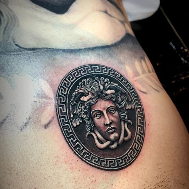 Close up of medusa medallion add to Greek mythology chest piece. #art #beauty…