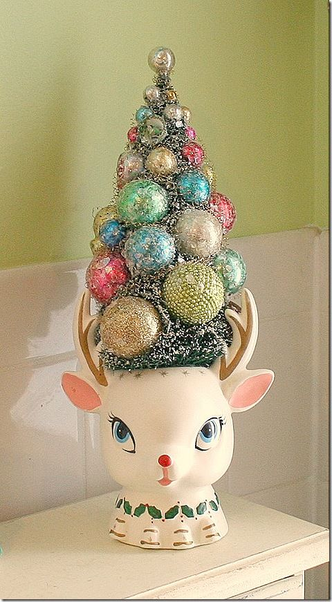 .I just bought a Rudolph like this-minus the tree and ornaments. It will be fun to fill it with my things. So cute.