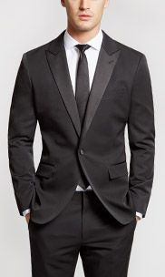 I could see Simon in this and the Groomsmen in vests....Bonobos.   The Capstone Slim - Black Tuxedo