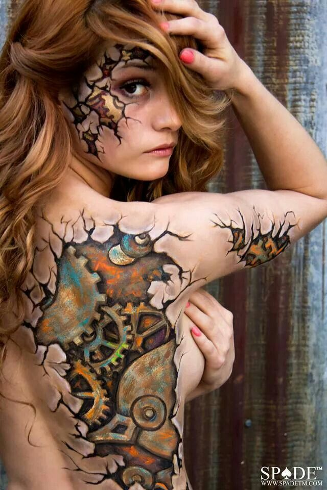Cracked steampunk gears body paint... But wouldn't this be a bada$$ tattoo