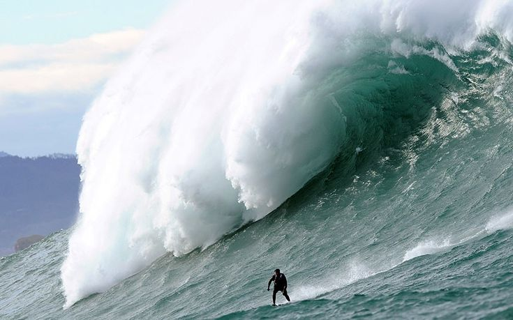A man surfs the Belharra giant waves a mile out to sea off the coast of the French Basque country town of Urrugne. Thanks to certain climatic conditions in autumn and winter, a strong swell hits the Belharra Perdun underwater spur, causing a 40 foot wave to form. This wave is only surfed by experts who are towed out by a water scooter. Picture: GAIZKA IROZ/AFP/Getty Images...