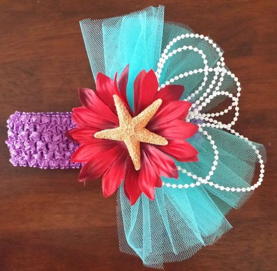 Little Mermaid Inspired Ariel Themed Hairpiece. This beautiful inspired headpiece features a purple crochet headband, teal tulle, red flower, pearl strands, re