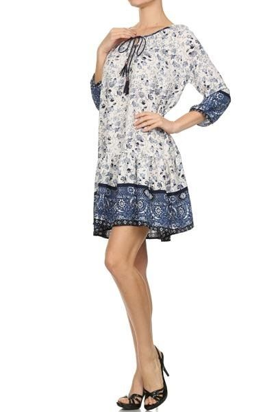 *** Floral Prairie Dress *** Printed 3/4 sleeve relaxed fit dress with string tassel tie detail on front.