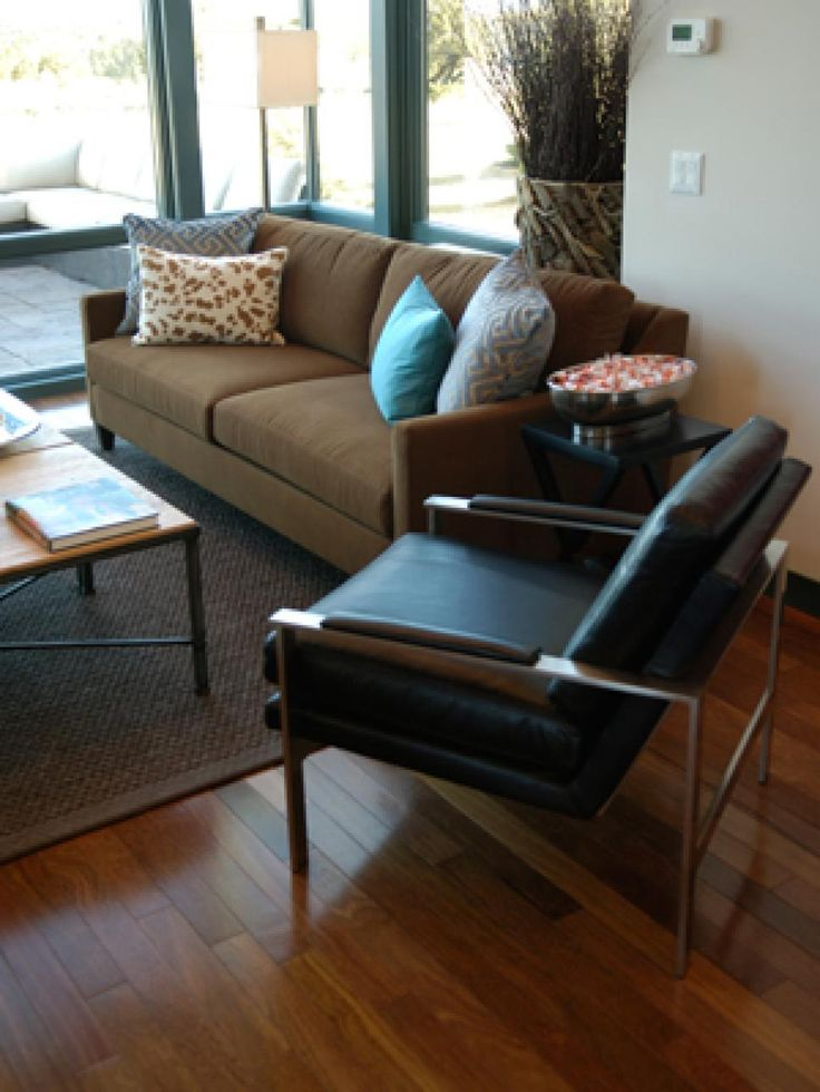 "A steel-framed leather chair and soft brown suede sofas lend a clean, tailored masculine touch. ""We picked the fabric for the sofas, and then we discovered that the gravel color was a paler version of the sofa leather. It was meant to be,"" says interior designer Linda Woodrum."