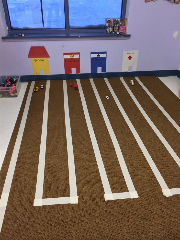 """This is kinda fun….they set up their own """"town"""" with roads taped on carpet to lead around town.  Represented home, fire dept, police dept and hospital.  Corresponding vehicles included."""