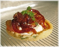 SugarPepper Cooks, Oxford Caterers - chive blini topped with goat's cheese creme fraiche and red onion 'marmalade' - canapes