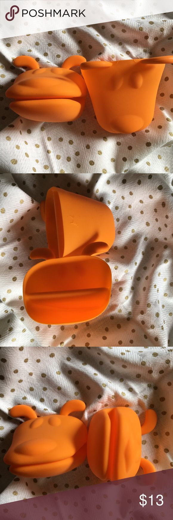 Adorable Orange Puppy Silicone Potholders So cute, never used, mostly bc we make a mess in the kitchen and I didn't want to ruin them. So they are like new, rec'd in a secret santa swap and I don't know what the brand is but there's a tiny little dog on the back of the holder that I tried to show in one photo. Great shower gift for a new couple! unknown Other