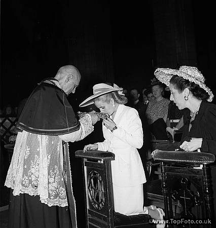 Eva Peron at Notre Dame in Paris. To the right is the wife of the ambassador of Argentina July 22, 1947.