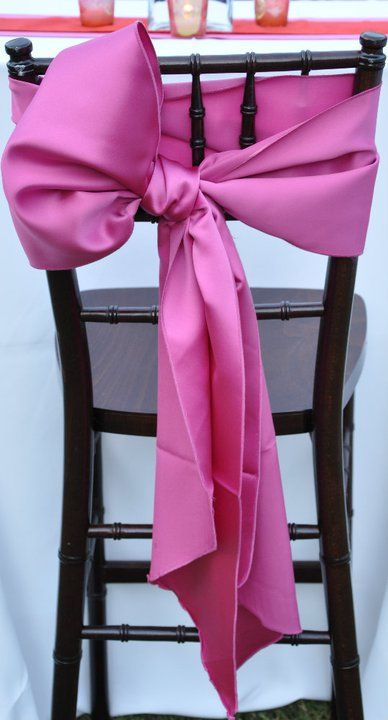 What about with a striped black and white bow! Could we dress up the existing chairs at the rotunda in this way.