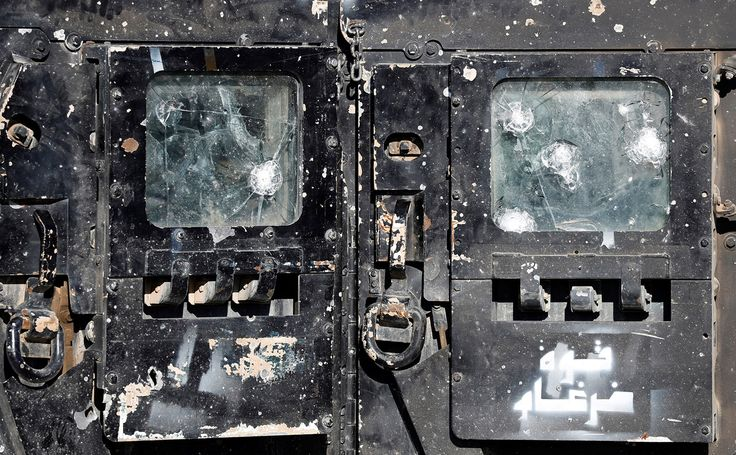 The battle scarred door of an Iraqi Special Forces armored Humvee after clashing with ISIS fighters on the outskirts of Mosul in February 2017 [1500x929]