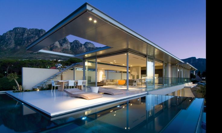 FIRST CRESCENT > A #minimalist #home, commanding a 270 degree view of Lions Head, Camps Bay & Atlantic Ocean, the living spaces of this #luxury home are highly transparent to take full advantage of the views. Spectacular #architecture by #SAOTA (Stefan Antoni Olmesdahl Truen #Architects)