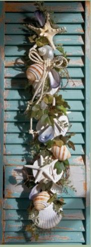 This is a great repurposing craft project to do after you've collected shells on your beach vacation!  Vertical Shell Swag hung on an old antique shutter.