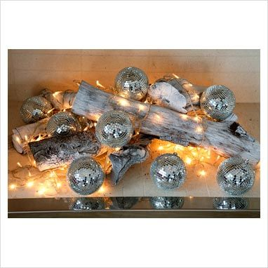 GAP Interiors - Fairy lights and Christmas decorations in fireplace - Picture library specialising in Interiors, Lifestyle & Homes