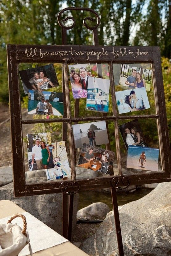 Couple photo display for a wedding with an old window.