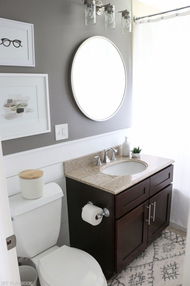 Bathroom makeover complete with DIY shiplap. From the gray walls, to the silver accents, we are loving everything in this small space. Just goes to show you don't need to spend a lot of money to make some big updates in a powder room.