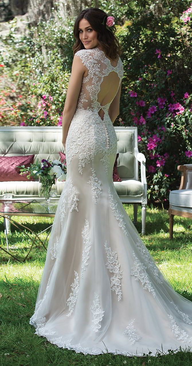This tulle and satin fit and flare gown is all about the keyhole back! The Queen Anne neckline with heavily adorned bodice and finished hem lace complete this beauty.