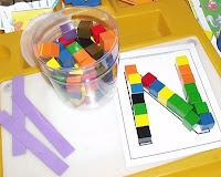 Alphabet center- ABC mats and cubes... count the cubes to make up the letter as well