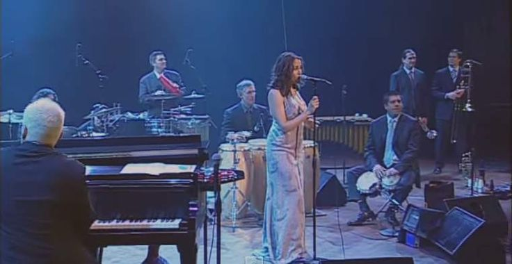"""The """"little orchestra"""" Pink Martini performs """"Let's Never Stop Falling In Love"""" from their second album """"Hang On Little Tomato"""" (2004)."""