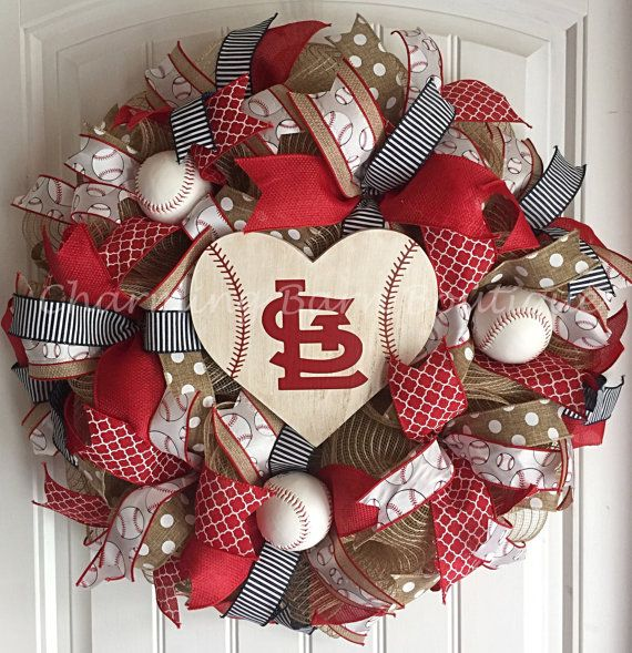 St.Louis Cardinals Wreath, St.Louis Cardinals Sign, St.Louis Cardinals Decor, St.Louis Decor, MLB Wreath, Baseball Wreath, Baseball Decor Go crazy folks!! Its baseball season! This St.Louis Cardinals wreath is the perfect way to show your Cardinals spirit. This baseball wreath is made with 21 natural colored deco mesh and decorated with SIX different wired ribbons and three real Rawlings baseballs throughout the wreath. Wooden heart shaped STL baseball sign that is handpainted to look dirt…