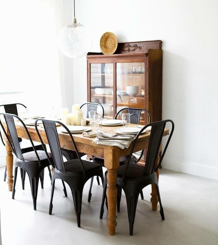 Love the combination of matt black metal chairs with the raw timber table. No frills, no fuss.