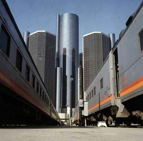 The Renaissance Center with Amtrack railroad cars.  Circa 1970s.
