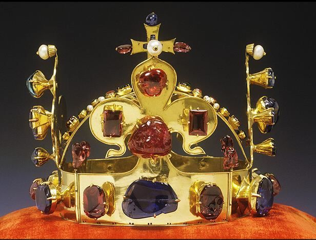 Crown of St. Wenceslaus: The crown was made in 1347 for the eleventh king of Bohemia (and Holy Roman Emperor) Charles IV. It is wrought of extremely pure gold and decorated with 19 sapphires, 44 spinels, 1 ruby, 30 emeralds and 20 pearls. Charles dedicated the crown to Saint Wenceslas, the patron saint of Bohemia