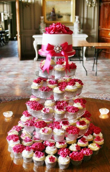 Hot Pink Wedding Cupcake Tower instead of pink do your pretty blue and navy @Britta Reed
