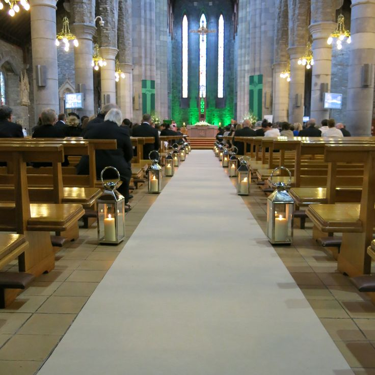 Simple Aisle Runner and Lanterns with Green Lighting. Visit www.gotchacovered.ie for more.